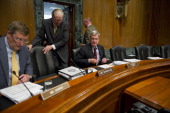 Chairman Max Baucus DMont right takes his seat with Sen Sen Kent Conrad DSD Sen John D Rockefeller IV DWVa as they arrive for a Senate Finance 'mock'...