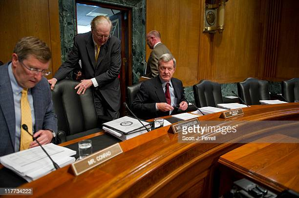 Chairman Max Baucus DMont right takes his seat with Sen Sen Kent Conrad DSD Sen John D Rockefeller IV DWVa as they arrive for a Senate Finance 'mock'...