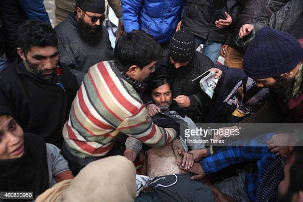 Chairman Mohammad Yasin Malik lies during a hunger strike to protest alleged highhandedness of police at Lal Chowk on December 24 2014 in Srinagar...