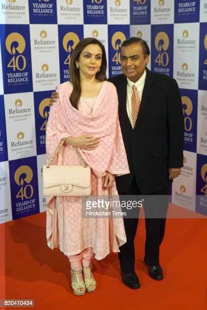 Chairman Mukesh Ambani with wife Nita Ambani pose for photograph before the 40th AGM of Reliance Industries Limited at Matoshree Hall on July 21 2017...
