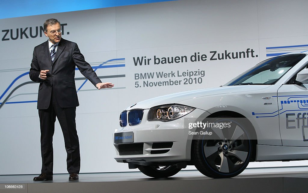 Chairman Norbert Reithofer speaks at the BMW auto assembly plant next to a BMW electric car on November 5 2010 in Leipzig Germany Later Reithofer and...
