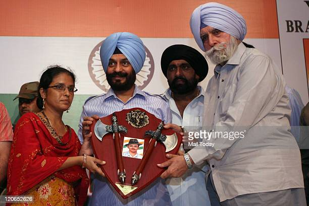 Chairman of All India Anti Terrorist Front MS Bitta with former Punjab DGP KPS Gill presenting bravery award trophy to Reshma Shahzad Rangrez who...