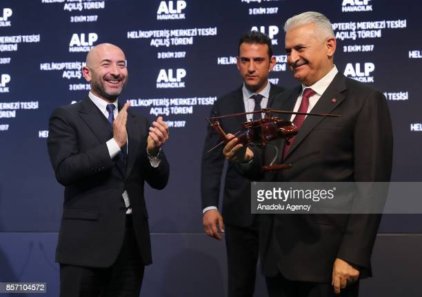 Chairman of Alp AviationTuncer Alpata presents a model Sikorsky Helicopter to Prime Minister of Turkey Binali Yildirim after the opening ceremony of...