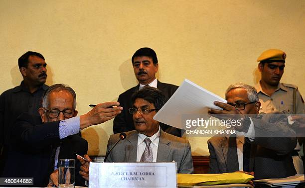 Chairman of an Indian Supreme Court appointed panel Rajendra Mal Lodha looks on as panel members Ashok Bhan and RVRaveendran pass documents during a...