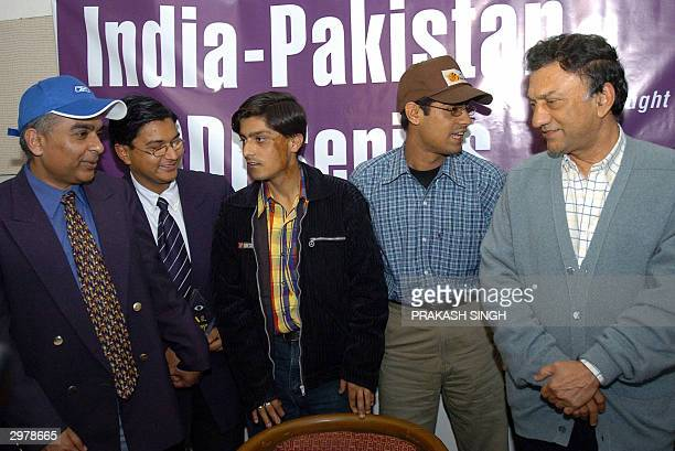 Chairman of Association for Cricket for the Blind in India George Abraham and former Indian Test Cricketer Abbas Ali Baig pose with some of the...