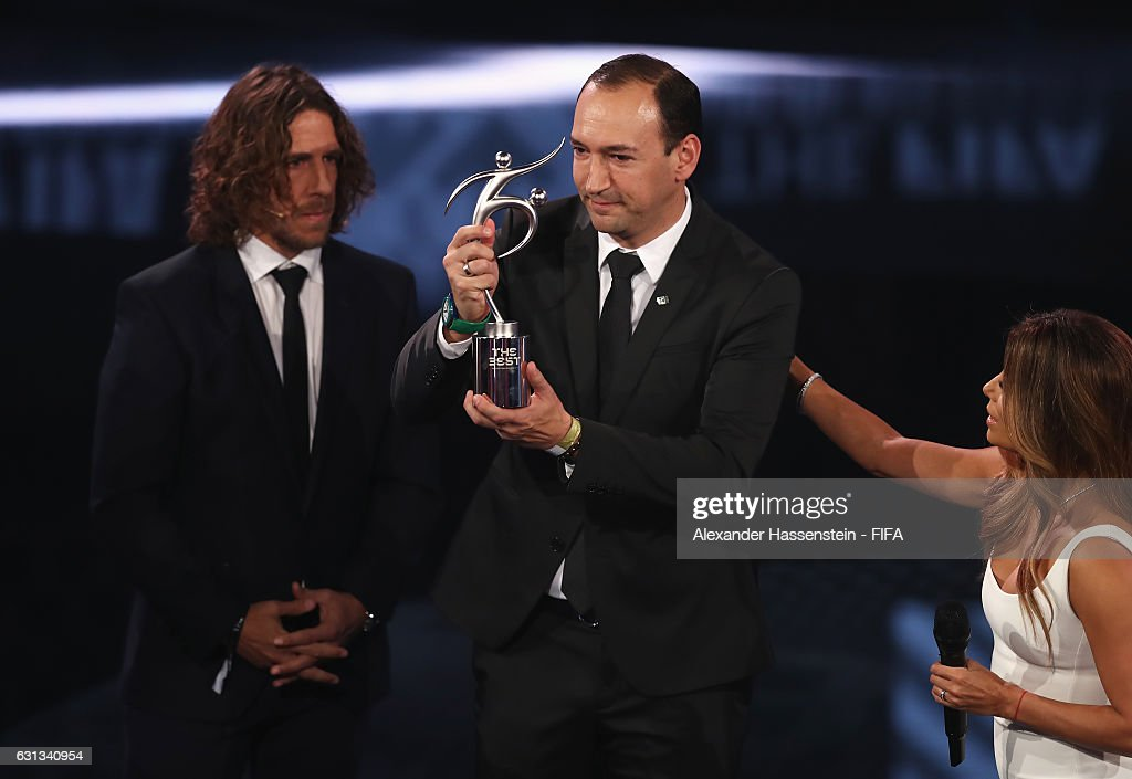 Chairman of Atletico National Juan Carlos de la Cuesta accepts the FIFA Fair Play Award from Carlos Puyol during The Best FIFA Football Awards at TPC Studio on January 9, 2017 in Zurich, Switzerland.