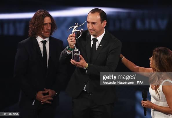 Chairman of Atletico National Juan Carlos de la Cuesta accepts the FIFA Fair Play Award from Carlos Puyol during The Best FIFA Football Awards at TPC...