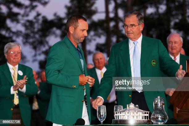 Chairman of Augusta National Golf Club William Porter Payne congratulates Sergio Garcia of Spain during the Green Jacket ceremony after Garcia won in...