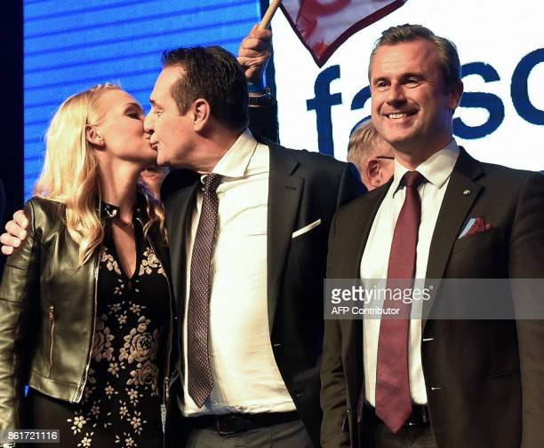 Chairman of Austria's farright Freedom Party HeinzChristian Strache kisses his wife Philippa Beck next to FPOe vicechairman Norbert Hofer as he...