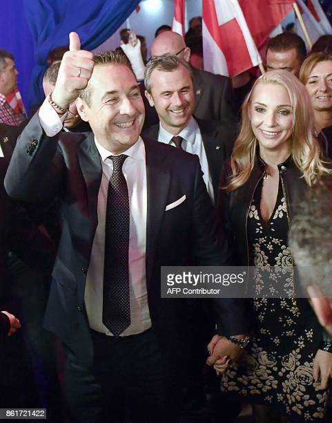 Chairman of Austria's farright Freedom Party HeinzChristian Strache and his wife Philippa Beck celebrate after the results of the general elections...