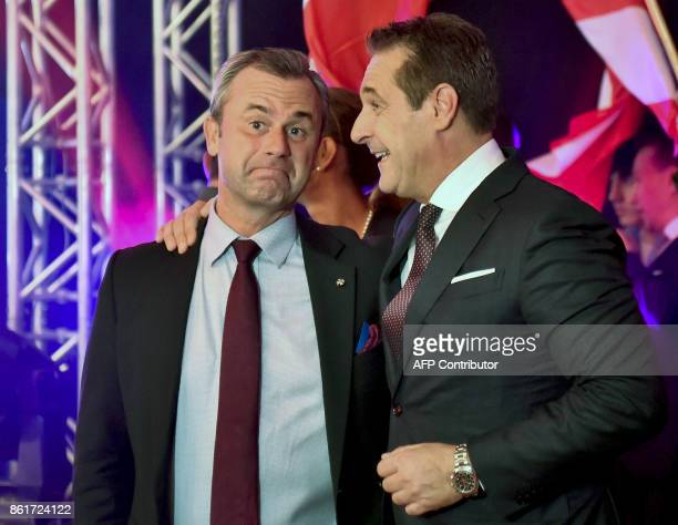 Chairman of Austria's farright Freedom Party HeinzChristian Strache and vicechairman Norbert Hofer celebrate after the results of the general...