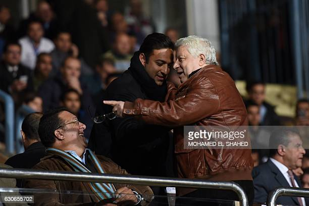 Chairman of Board of Directors of the club Zamalek Chancellor Mortada Mansour speaks with former Egyptian national team player Ahmed Hossam during...