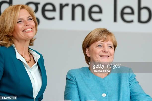 Chairman of CDU RheinlandPfalz Julia Kloeckner and German Chancellor and head of the German Christian Democrats Angela Merkel are seen on stage at an...