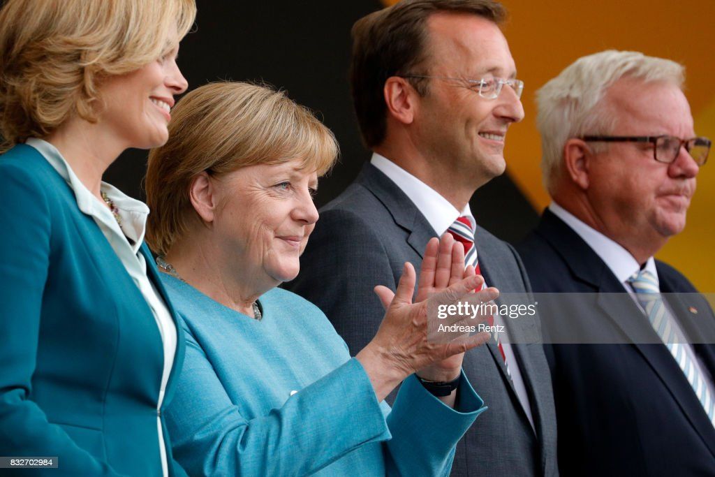 Chairman of CDU Rheinland-Pfalz Julia Kloeckner, German Chancellor and head of the German Christian Democrats (CDU) Angela Merkel, Josef Oster, candidate for the German parliament, and Michael Fuchs greet supporters after an election rally at the headland known as the 'Deutsches Eck' ('German Corner'), where the Mosel and Rhine rivers meet, on August 16, 2017 in Koblenz, Germany. Germany is scheduled to hold federal elections on September 24 and Merkel, who is running for a fourth term as chancellor, currently holds a double-digit lead over Martin Schulz from the German Social Democrats (SPD), her main opponent.