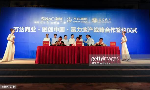 Chairman of China's Wanda Group Wang Jianlin attends the signing ceremony for the strategic partnership between Wanda Group Sunac and RF Properties...
