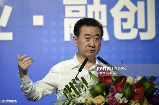 Chairman of China's Wanda Group Wang Jianlin gives a speech during the signing ceremony for the strategic partnership between Wanda Group Sunac and...