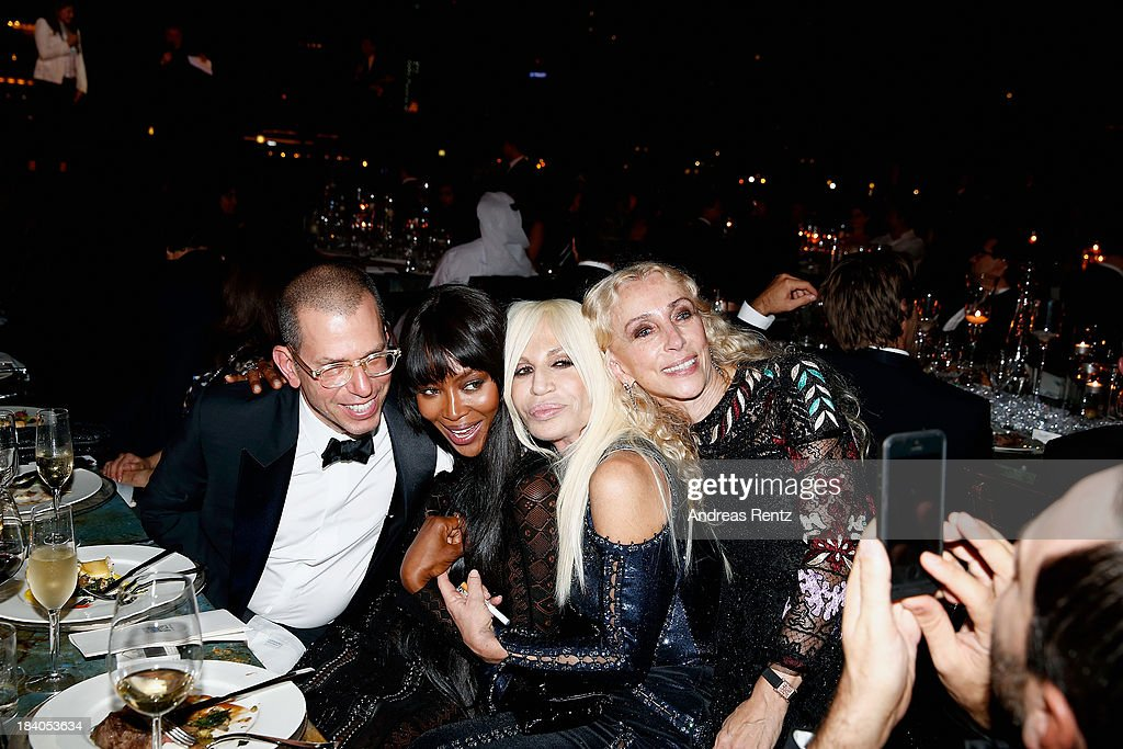 Chairman of Conde Nast International Jonathan Newhouse, model Naomi Campbell, Donatella Versace and Editor-in-chief of Vogue Italia Franca Sozzani attend the gala dinner at the Armani Pavilion during Vogue Fashion Dubai Experience on October 10, 2013 in Dubai, United Arab Emirates.