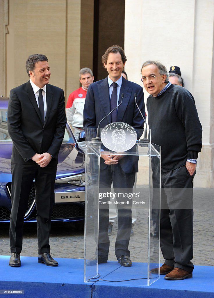 Chairman of Fiat Chrysler Automobiles <a gi-track='captionPersonalityLinkClicked' href=/galleries/search?phrase=John+Elkann&family=editorial&specificpeople=571803 ng-click='$event.stopPropagation()'>John Elkann</a>, Italian Prime Minister <a gi-track='captionPersonalityLinkClicked' href=/galleries/search?phrase=Matteo+Renzi&family=editorial&specificpeople=6689301 ng-click='$event.stopPropagation()'>Matteo Renzi</a> and CEO of Fiat Chrysler Automobiles <a gi-track='captionPersonalityLinkClicked' href=/galleries/search?phrase=Sergio+Marchionne&family=editorial&specificpeople=608333 ng-click='$event.stopPropagation()'>Sergio Marchionne</a> attend the unveiling of Italian car manufacturer Alfa Romeo's latest car The Alfa Romeo Giulia on May 5, 2016 in Rome, Italy.