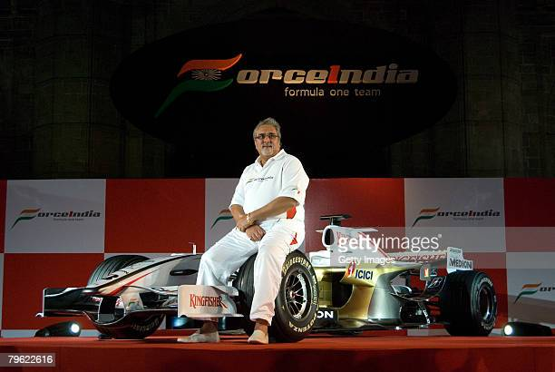 Chairman of Force India F1 team Vijay Mallya poses with the new Force India Formula One Team car on display at the launch held infront of the Gateway...