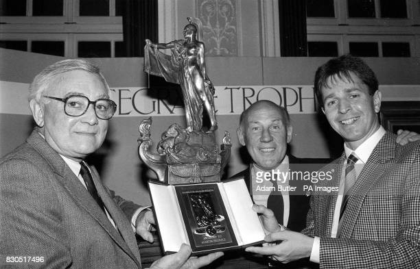 Chairman of Ford Europe Walter Hayes presenting the 1988 Segrave Trophy to Martin Brundle watched by Stirling Moss 27/12/00 Former Aston Martin...