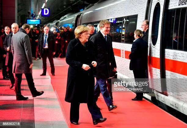 Chairman of German railway operator Deutsche Bahn Richard Lutz and German Chancellor Angela Merkel walk towards a special ICE high speed train at the...