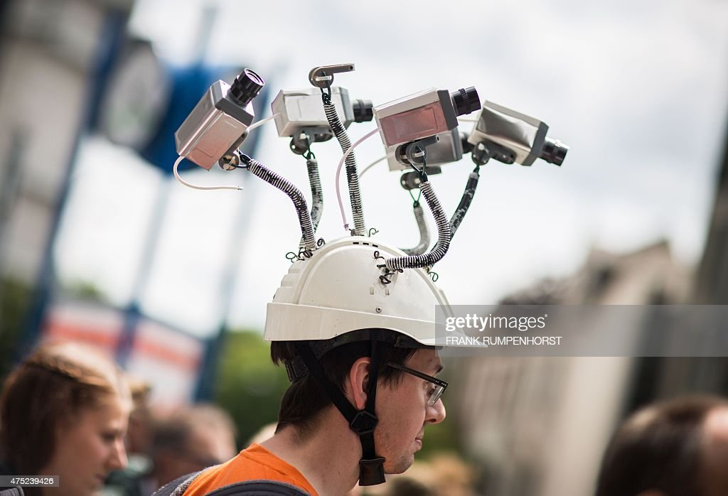 Chairman of Hesse's Pirate Party Volker Berkhout wears a hat with mock surveillance cameras during a demonstration against spying activities of the...