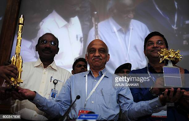 Chairman of Indian Space Research Organisation ASKiran Kumar Rao poses holding a model of satellite INSAT3DR which was on board the Geosynchronous...
