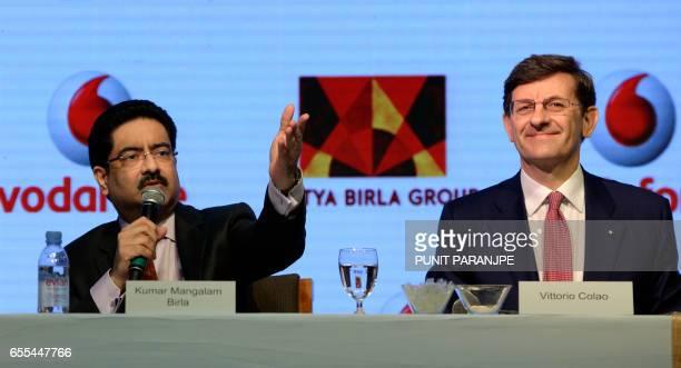 Chairman of India's Aditya Birla Group Kumar Mangalam Birla speaks as Vodafone Group CEO Vittorio Colao watches during a news conference in Mumbai on...