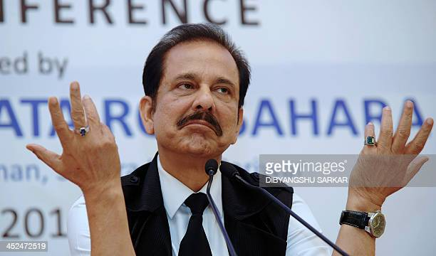 Chairman of India's Sahara Group Subrata Roy gestures as he addresses a press conference in Kolkata on November 29 2013 An Indian regulator froze the...
