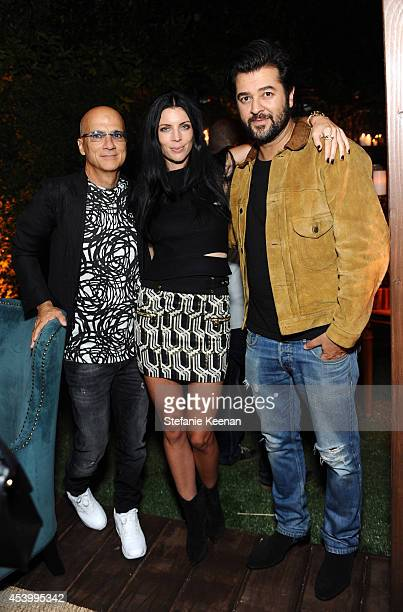 Chairman of Interscope Geffen AM Jimmy Iovine model and designer Liberty Ross and Creative Director and owner of Genetic Denim Ali Fatourechi attend...
