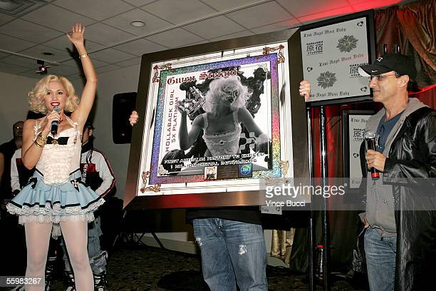 Chairman of Interscope Geffen AM Records Jimmy Iovine presents singer Gwen Stefani an award for being the 'First Artist in History to exceed 1...