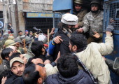 Chairman of Jammu Kashmir Liberation Front Yasin Malik is detained by Indian police during a protest march against a military court verdict in...