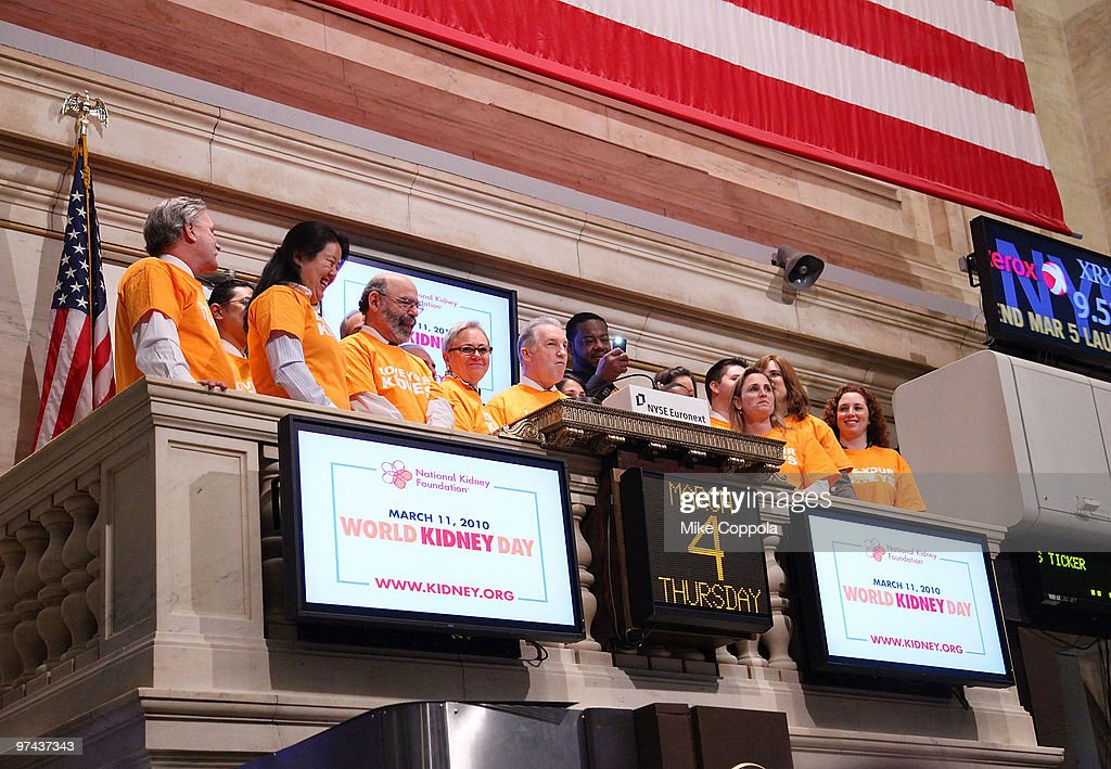 Chairman of National Kidney Foundation Bill Cella and actor Grizz Chapman ring the opening bell at the New York Stock Exchange on March 4 2010 in New...