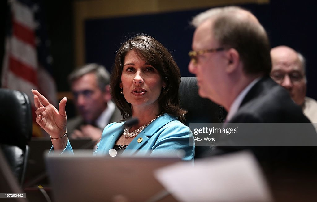 Chairman of National Transportation Safety Board Deborah Hersman (C) speaks as board member Robert Sumwalt (R) listens during an investigative hearing into the Boeing 787 battery fire before the NTSB April 23, 2013 in Washington, DC. The NTSB held a two-day hearing to investigate the design, testing, certification and operation of the lithium-ion battery on the Boeing 787 and the battery fire incident.