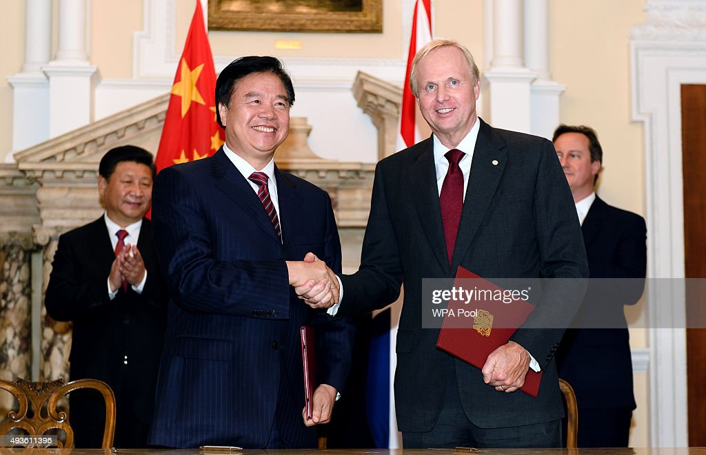 Chairman of oil and gas company Petro China, Wang Yilin (L), shakes hands with the Chief Executive of oil and gas company BP, Bob Dudley, during a commercial contract exchange at the UK-China Business Summit in Mansion House on October 21, 2015 in London, England.