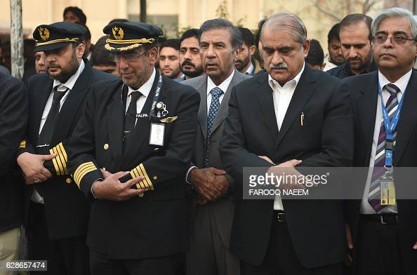 Chairman of Pakistan International Airlines Azam Saigol along with Pakistan International Airline officials offer absentia funeral prayers for plane...