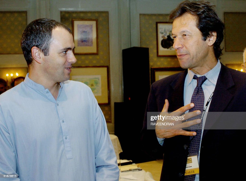 Chairman of Pakistan's TehreekeInsaf party and former Cricket captain Imran Khan talks with Indian administered Kashmir's National Conference Party...