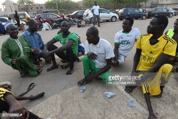 Chairman of Polio Victims Trust Association Aminu Ahmed speaks to Kano Pillars parasoccer players during a training session in Kano northwestern...