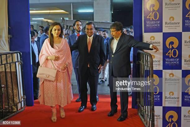 Chairman of RIL Mukesh Ambani with wife Nita Ambani and son Anant Ambani arrives for the 40th AGM of Reliance Industries Limited at Matoshree Hall on...