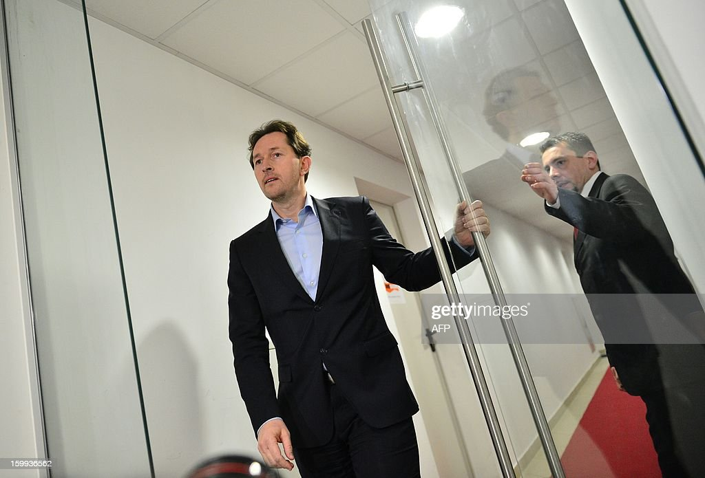 chairman of Slovenia's Parliament Gregor Virant opens a door prior a media address on January 23, 2013 in Ljubljana after agreeing to to adress the media after accepting to step out of the coalition. A general strike by tens of thousands of public sector workers paralysed Slovenia on Wednesday, adding to Prime Minister Janez Jansa's woes as he struggles to hang on in office. As thousands took part in demonstrations in the capital Ljubljana and other cities, union leaders put the number of people striking at up to 100,000 -- one of the biggest shows of force since independence from Yugoslavia in 1991. AFP PHOTO / JURE MAKOVEC