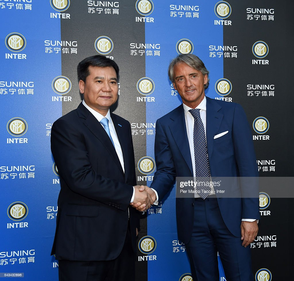 Chairman of Suning Holdings Group Zhang Jindong and Head Coach of FC Internazionale <a gi-track='captionPersonalityLinkClicked' href=/galleries/search?phrase=Roberto+Mancini&family=editorial&specificpeople=234429 ng-click='$event.stopPropagation()'>Roberto Mancini</a> attend a gala dinner after the FC Internazionale Shareholder's Meeting on June 28, 2016 in Milan, Italy.