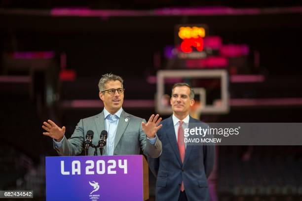 Chairman of the LA 2024 Casey Wasserman speaks as Los Angeles mayor Eric Garcetti looks on during a press conference at the Staples Center concluding...