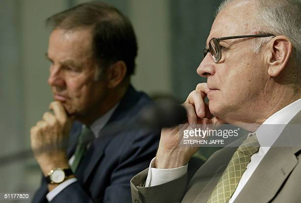 Chairman of the 9/11 Commission Thomas Kean and Vice Chairman of the 9/11 Commission Lee Hamilton listen to opening statements prior to testifying...