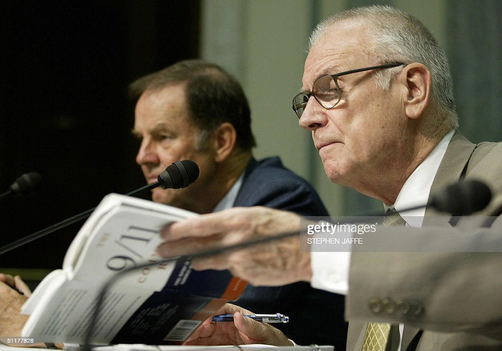 Chairman of the 9/11 Commission Thomas Kean (L) flanks Vice Chairman of the 9/11 Commission Lee Hamilton (R) as he goes through a copy of the 9/11 Commission report prior to testifying before the Senate Committee on Commerce 16 August, 2004 on Capitol Hill in Washington, DC. AFP PHOTO/Stephen JAFFE