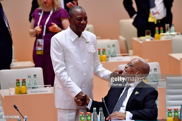 Chairman of the African Union Alpha Conde and South Afrcian President Jacob Zuma chat prior to the morning working session on the second day of the...