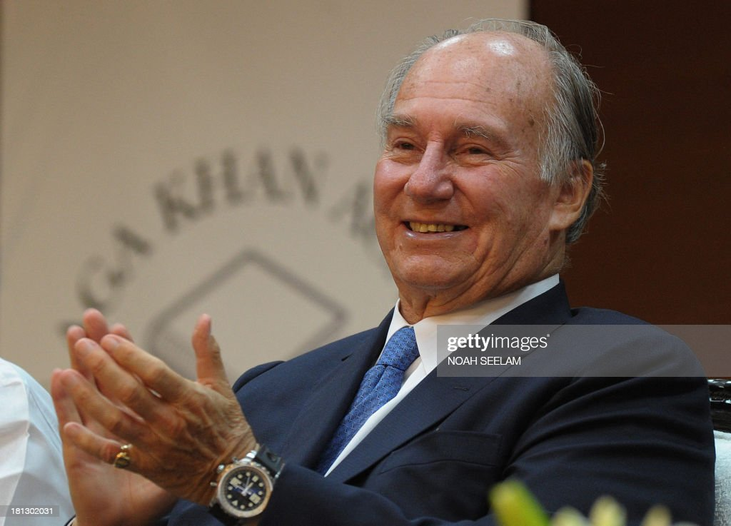 Chairman of the Aga Khan Development Network, Aga Khan claps during the inauguration ceremony of The Aga Khan Academy in Hyderabad on September 20, 2013. The Academy is the second in a global network of day and residential schools being established across South and Central Asia, Africa and the Middle East, and aims to develop home-grown leaders with a strong sense of ethics and civic responsibility. AFP PHOTO/ Noah SEELAM