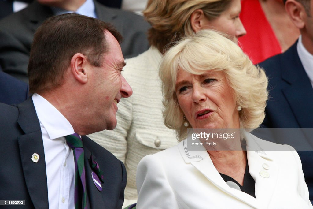 Chairman of the All England Lawn Tennis Club Phillip Brook and Camilla, the Duchess of Cornwall are in conversation as they watch on from the stands in centre court as Julien Benneteau of France is in action during the Men's Singles second round match against Kei Nishikori of Japan on day four of the Wimbledon Lawn Tennis Championships at the All England Lawn Tennis and Croquet Club on June 30, 2016 in London, England.