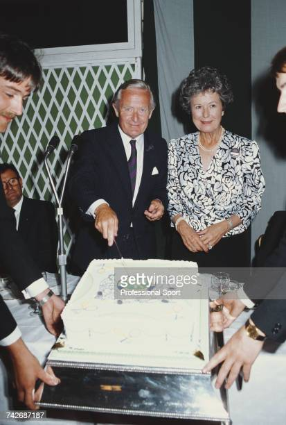 Chairman of the AllEngland Club Buzzer Hadingham pictured with his wife Lois as he cuts the centenary cake during a ceremony on day 10 of the 1986...