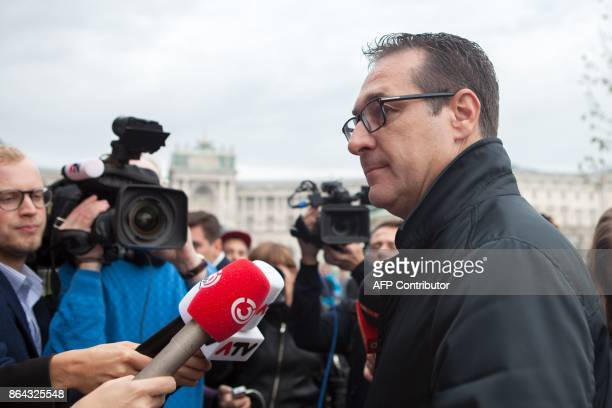 Chairman of the Austrian Freedom Party HeinzChristian Strache answers journalists' questions as he arrives for talks with Foreign Minister and...