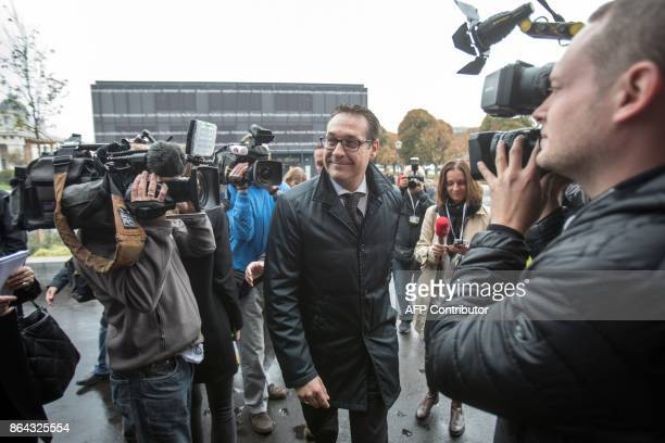 Chairman of the Austrian Freedom Party HeinzChristian Strache is surrounded by journalists as he arrives for talks with Foreign Minister and chairman...